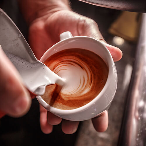 barista-makes-coffee-latte-art-PLE8Y3P.jpg